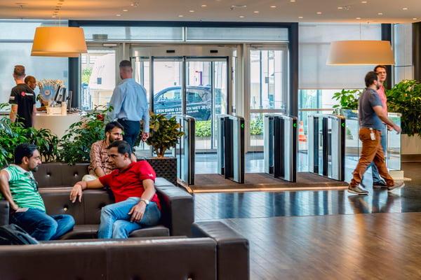 Optical turnstiles help reception staff regulate the flow of people