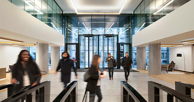 Security access turnstiles can be considered a part of the means of egress as long as the building is protected by an automatic sprinkler system